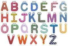 Alphabet. Latin alphabet for children isolated on white background. There are cute eyes and vivid colors, childish and simple figures on every letter. Letters stock image