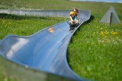 Children in alpine coaster Royalty Free Stock Image