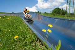 Children in alpine coaster Royalty Free Stock Image