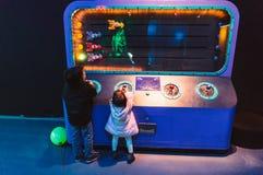 Children in an amusement arcade Stock Image
