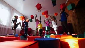 Children and animators fun throw the dice up. Animators entertain children. A children`s party. Close up stock footage