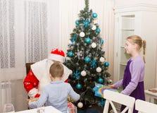 Children meet Santa Claus. Children in the apartment meet Santa Claus on New Year`s night stock photos