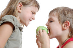 Children with an apple royalty free stock photography