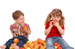 Children with apples on a white Royalty Free Stock Photos
