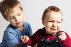 Children argue  and cry Royalty Free Stock Photos