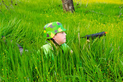 Boy soldier hiding in tall grass Stock Photos