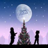 Children around the Christmas tree Stock Images