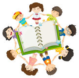 Children around the open book Royalty Free Stock Photography