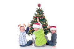 Children around Xmas three Royalty Free Stock Photos