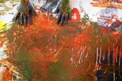 Children artist hands painting multi colors Royalty Free Stock Images