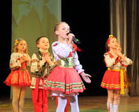 Children artists in national dress. Speech by the art group Soniah on the stage of the Kyiv Palace of children and youth. Yuileyny concert dedicated to the Royalty Free Stock Images