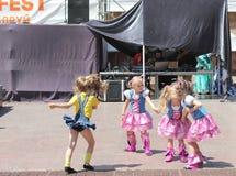 Children artists. Performance of children's dancing group Royal Ballet on the street scene. Festival street food. June 2015. Kiev royalty free stock photo