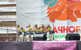 Children artists. Performance of children's dancing group Royal Ballet on the street scene. Festival street food. June 2015. Kiev royalty free stock images