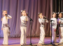 Children artists vocalists. Performance vocal choreographic art group sleepyheads on the stage of the Kyiv Palace of children and youth. The festival Steps Stock Photo