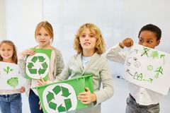 Children are planning a recycling project. Children as elementary school creative team are planning a recycling ecology project royalty free stock images