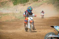 Children athletes on the track. MOSCOW, RUSSIA - SEPTEMBER 15, 2018: Unrecognized young athletes,in the Velyaminovo Race Weekend 2018, Motopark Velyaminovo stock images