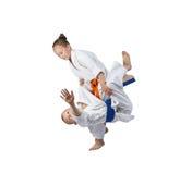 Children athletes train judo throws Royalty Free Stock Photos
