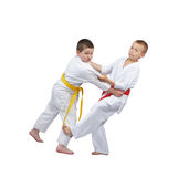 Children athletes are training slicing down under leg Royalty Free Stock Photos