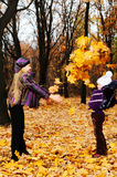 Children in autumn forest Royalty Free Stock Photos