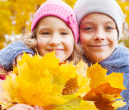 Children at autumn stock photography