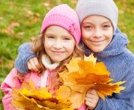 Children at autumn Stock Photos