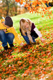 Children in the autumn park Royalty Free Stock Image