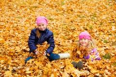 Children at autumn park Stock Photography