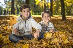 Children in the autumn park. stock image