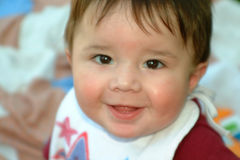 Children-Baby Smiling 2. Close up of smiling baby boy with a small DOF Royalty Free Stock Image