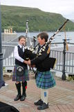 Children bagpiepers in Portree. Two children bagpipers in Portree of Skye Royalty Free Stock Photography