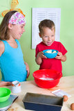 Children bake a cake with joy Royalty Free Stock Image