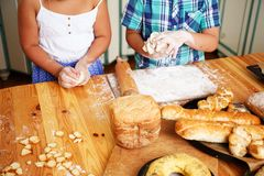 Children with baked goods. Children cooking homemade pastry close up Royalty Free Stock Photography
