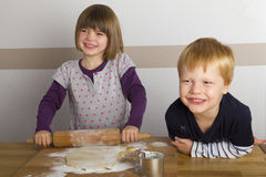 Children baking Stock Images