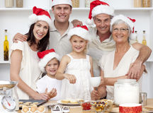 Children baking Christmas cakes with their family Stock Image