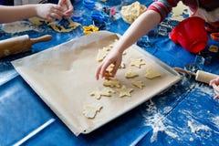 Children baking Christmas cookies Stock Image