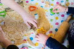 Children Baking Christmas Cookies cutting pastry Stock Images