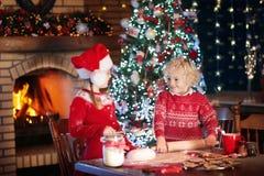 Child baking Christmas cookies. Kids bake for Xmas Royalty Free Stock Image