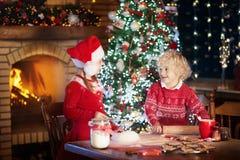 Child baking Christmas cookies. Kids bake for Xmas Stock Photography