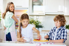 Children baking fruitcake with red currants Stock Photography