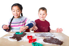 Children baking gingerbread Stock Photo