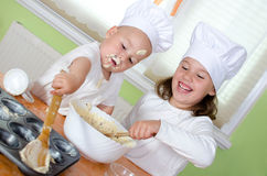 Children baking muffins Stock Image