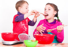 Children when baking. Siblings while baking the background against white Royalty Free Stock Image