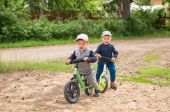 Children on a balance bike Royalty Free Stock Images