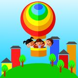 Children in a  balloon. Children on a colorful hot air balloon over the city Royalty Free Stock Photography