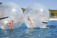 Children in a balloon floating on water. Royalty Free Stock Photography