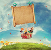 Children in a balloon on a glade Stock Image