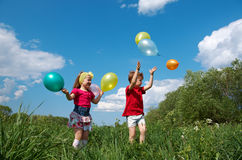 Children with balloon outdoor Stock Image