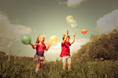 Children with balloon outdoor Stock Photography