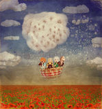 Children in a balloon  over  field of red poppies Stock Photos