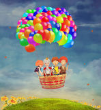Children in a balloon. In the sky Royalty Free Stock Photos